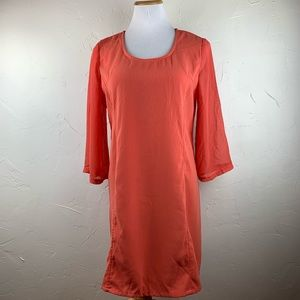 Miilla orange crepe dress with sheer bell sleeves